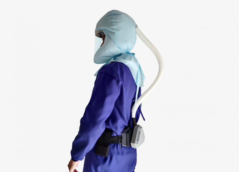 man wearing papr ultrahood side view